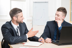 Waist-up portrait of two handsome businessmen in Stock Photos