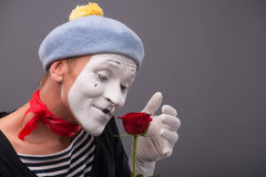 Waist-up portrait of young male mime holding a Stock Photography