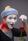 Waist-up portrait of young male mime holding a Royalty Free Stock Images