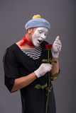 Waist-up portrait of young male mime holding a Stock Photo