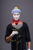 Waist-up portrait of young male mime holding a Stock Image