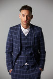 Waist up portrait of young man wearing a large check suit Royalty Free Stock Photo