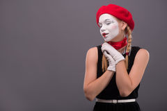Waist-up portrait of young mime girl showing Royalty Free Stock Photos