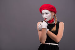 Waist-up portrait of young mime girl showing Royalty Free Stock Photo