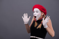Waist-up portrait of young mime girl showing Stock Image