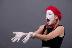 Waist-up portrait of young mime girl showing Royalty Free Stock Image