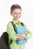 Waist up of schoolboy with backpack,  on white background. Royalty Free Stock Images