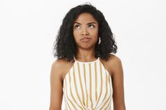 Waist-up shot of clueless and questioned silly african american girl trying understand what made wrong looking up. Thoughtful with no clues posing unaware over royalty free stock images