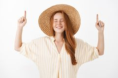 Waist-up shot of optimistic dreamy and happy girlfriend with red hair and freckles closing eyes with joyful look royalty free stock photography