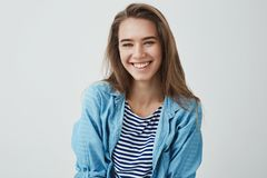 Waist-up shot tender carefree friendly-looking modern gorgeous european woman smiling pleased carefree having amusing. Funny conversation playing-around royalty free stock image