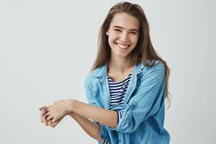 Waist-up studio shot charming tender feminine girlfriend laughing out loud showing happiness positive optimistic. Attitude pressing palms together silly flirty royalty free stock photography
