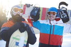 Two male snowboarders. Waist up of two male snowboarders Stock Photo