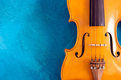 Waist of violin against blue Royalty Free Stock Images