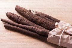 Waistband salsify in paper bag Royalty Free Stock Images