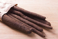 Waistband salsify in paper bag Royalty Free Stock Photo