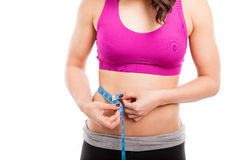 Waistline of a fit woman Stock Photography