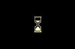 Wait. Photo of hourglass symbol on the monitor shows the wait sign on the black background Stock Photography