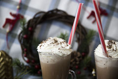 Wait for Christmas drinking cocoa with whipped cream royalty free stock image