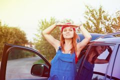 Wait for help on the road. Portrait of a young woman in working form, looking into the distance waiting for help royalty free stock photo