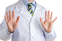 Wait and listen gesture by man in medical coat Stock Photography