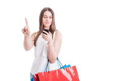 Wait a minute concept with young shopaholic reading something im Stock Image