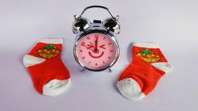 Clock and sock. Christmas. Royalty Free Stock Image