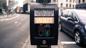Wait signs in London. Wait sign for crossing street in London Royalty Free Stock Photo