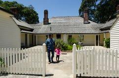 Waitangi Treaty Grounds. WAITANGI - JAN 07:Visitors (Talya Ben-Ari age 3) at the Treaty House on Jan 07 2014 in Waitangi, NZ.The Treaty of Waitangi was signed in Royalty Free Stock Image