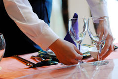 Waiter. A waiter is puting glasses Stock Images