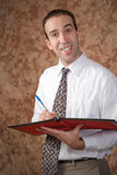 Waiter. A waiter holding a pen and a binder about to take someone's order Stock Photos