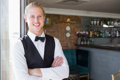 Waiter with arms crossed in restaurant Stock Photo