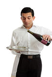 Waiter or bartender pouring wine Royalty Free Stock Photography