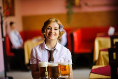 Waiter with beer in the hands Royalty Free Stock Images