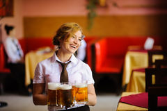 Waiter with beer Royalty Free Stock Images