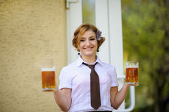 Waiter with beer Royalty Free Stock Photography