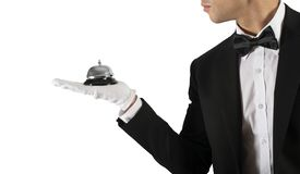 Waiter with bell in hand. Concept of first class service in your business royalty free stock images
