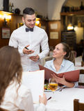 Waiter with beverages Royalty Free Stock Image