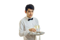 Waiter with black hair holding a tray with two glasses Stock Photo