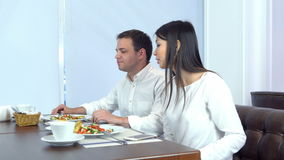 Waiter bringing wrong bill to the impatient young couple stock video