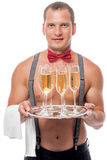 The waiter brings the champagne Royalty Free Stock Image