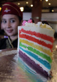 A waiter brings rainbow cake Stock Photos