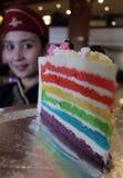 A waiter brings rainbow cake Stock Photos
