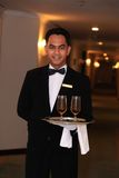 Waiter or butler. Photograph of waiter or butler at hotel corridor Royalty Free Stock Image