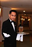 Waiter or butler. Photograph of waiter or butler at hotel corridor Royalty Free Stock Photo