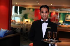 Waiter or butler. Photograph of waiter or butler at restaurant Royalty Free Stock Image