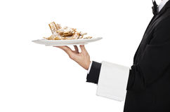Waiter with carnival cake chiacchere Royalty Free Stock Photos