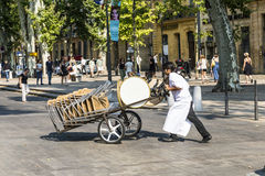 Waiter Carries Tables For The Outdoor Restaurant With A Sack Bar Royalty Free Stock Images