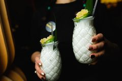 Waiter carries two white cocktails.  royalty free stock photography