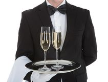 Waiter carrying champagne flutes on tray Royalty Free Stock Image