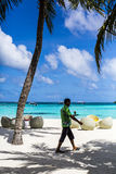 Waiter carrying a drink on a tropical beach resort in the Maldives Stock Photo